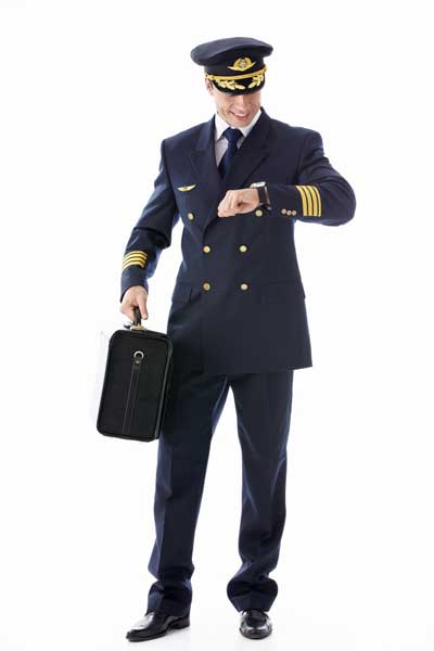 airline pilot checking wristwatch