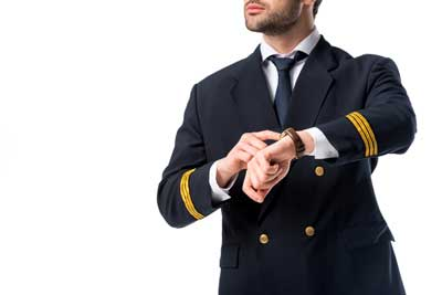 pilot checking the time