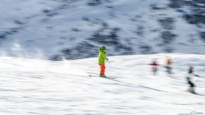 skier coming down ski slope