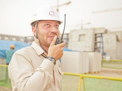 construction worker with walkie talkie