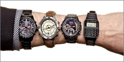 wrist with four different watch types