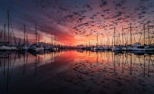 marina with sail boats sunset