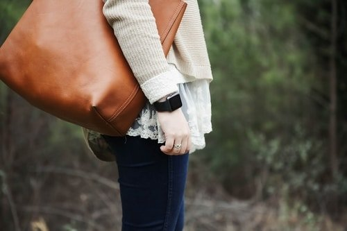 woman black watch leather bag