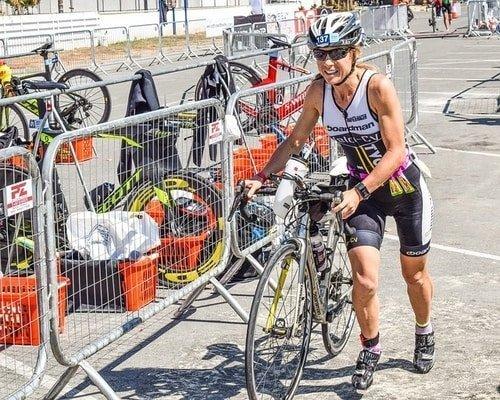 triathlon woman with bike