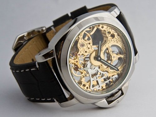 close up of skeleton watch face