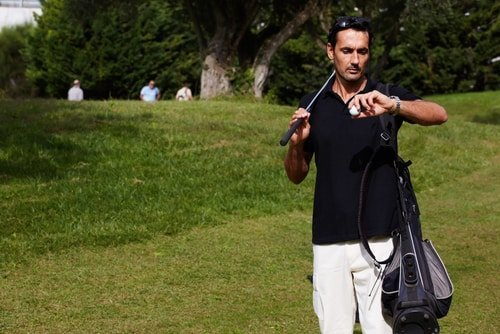 Golfer checking his watch