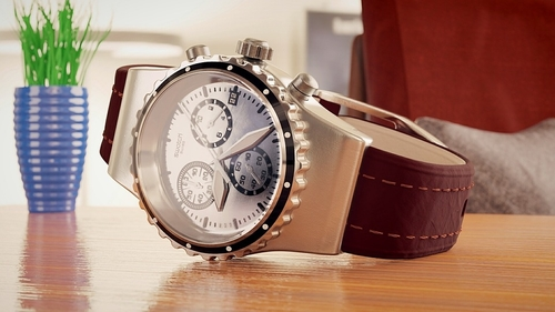 Photo of a Swatch chronograph resting on a table