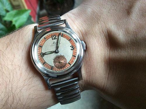 Man wearing Mido watch