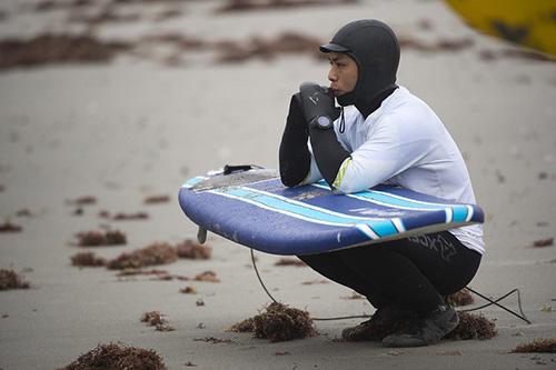 Surfer wearing surfing watch