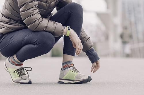 Sporty woman wearing fitness tracker