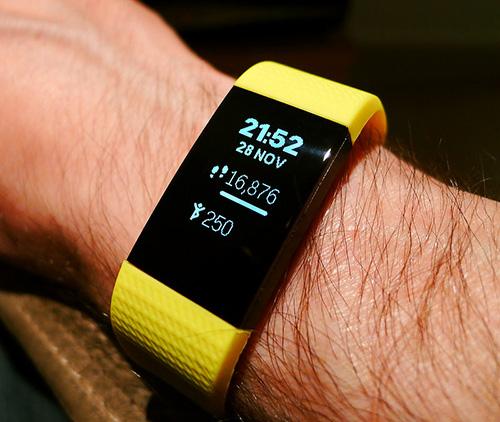 Wearing Fitbit fitness tracker