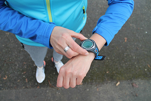 Person wearing waterproof fitness smartwatch