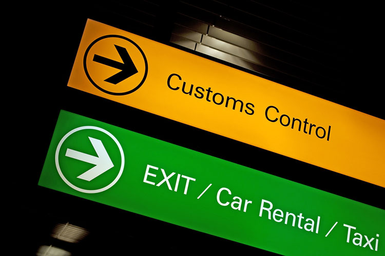 Airport customs, exit, car rental and taxi sign.