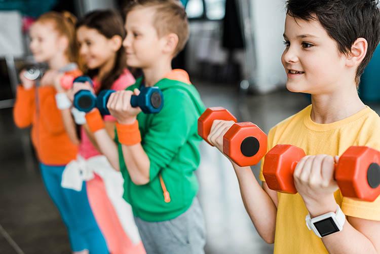 children exercising using smartwatch
