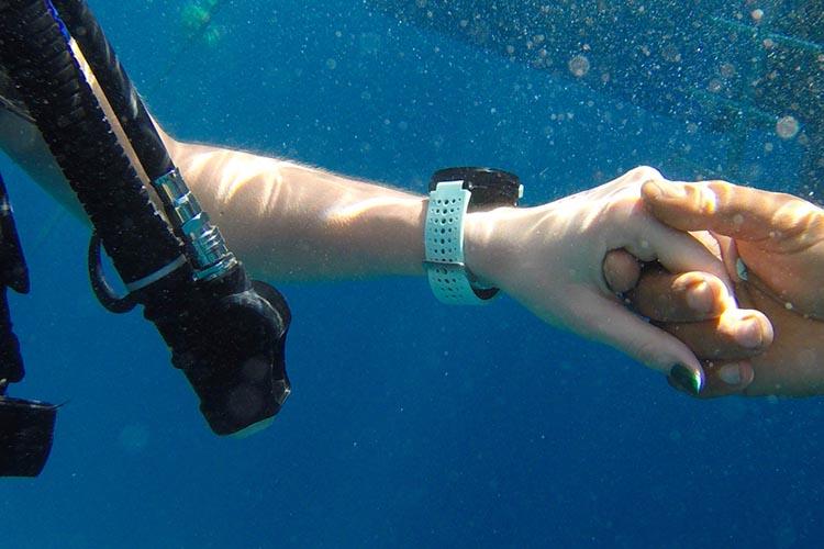 girl wearing watch in underwater diving