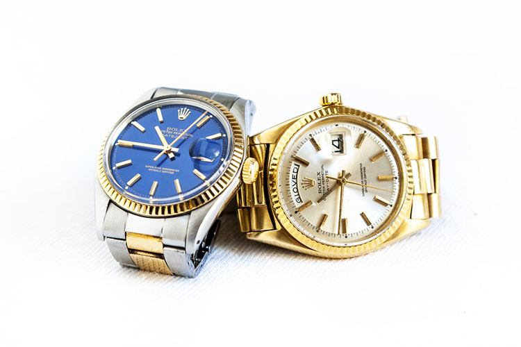 Rolex Oyster Perpetual Day- Date and Oyster Blue watch on white