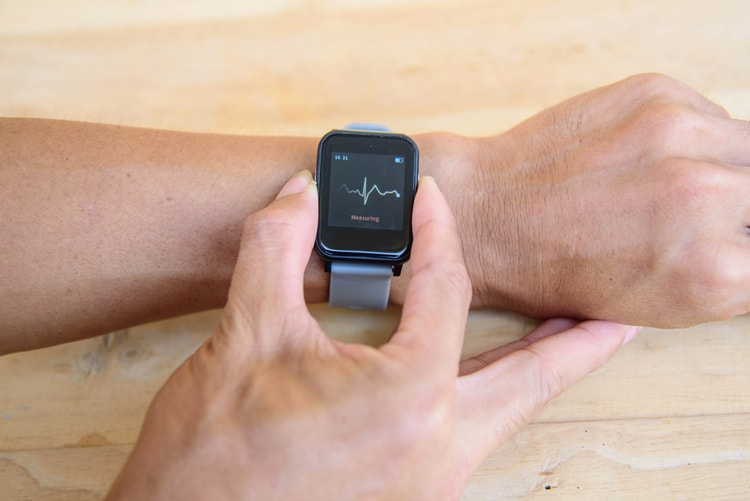 man checking heart on smartwatch