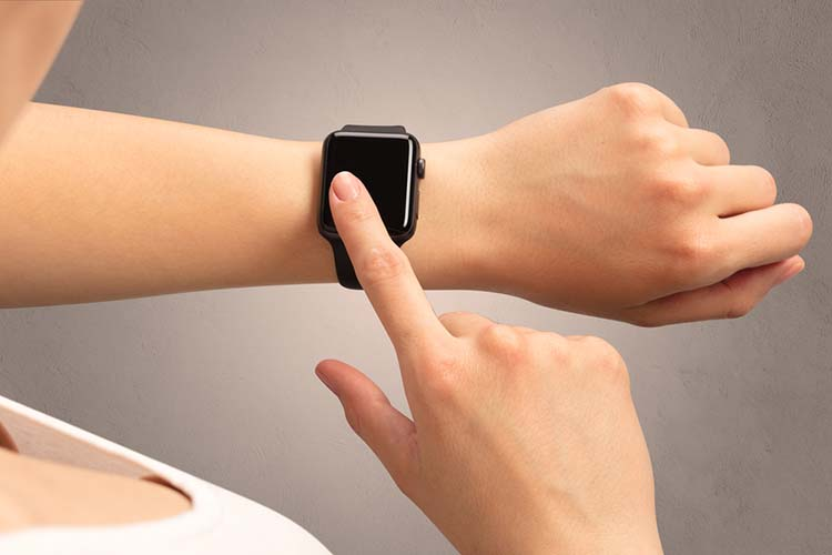Female hand with black screen smartwatch.