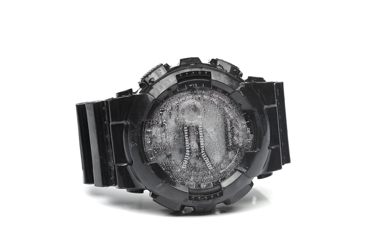 Water droplets inside a digital watch isolated / A water damaged watch