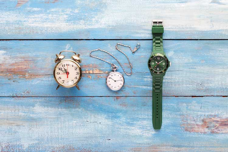 Old and new watches on a wooden board